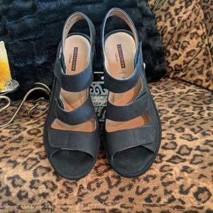 Black Clark's adjustable sandals
